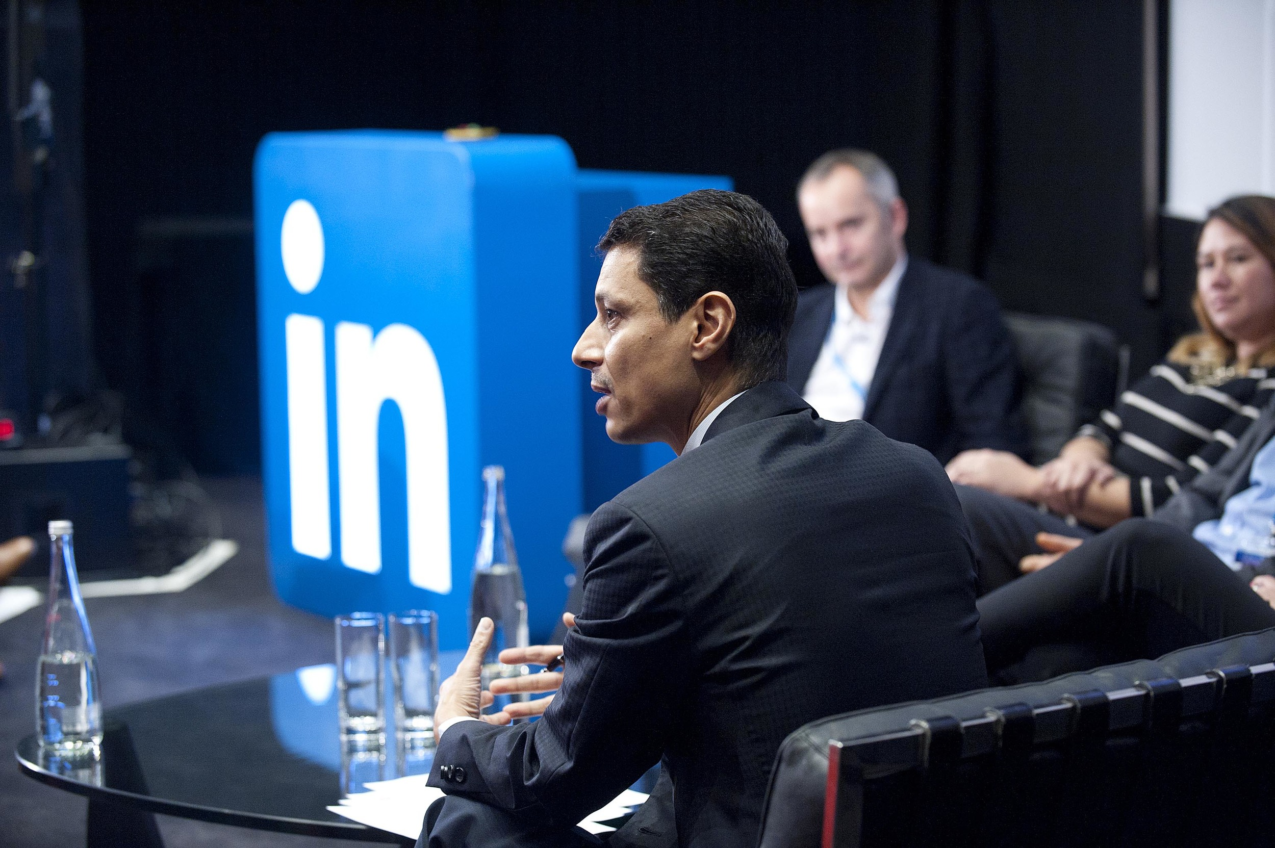 A businessman speaking at a Conference Event for Linkedin