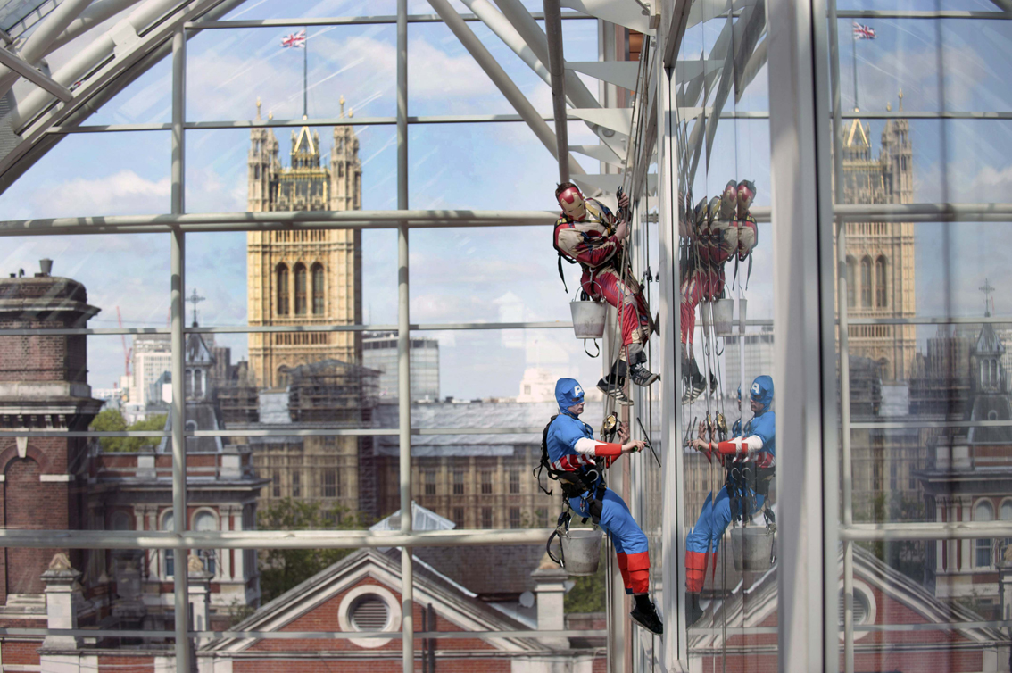 Superhero window cleaners at St Thomas' Hospital scale building