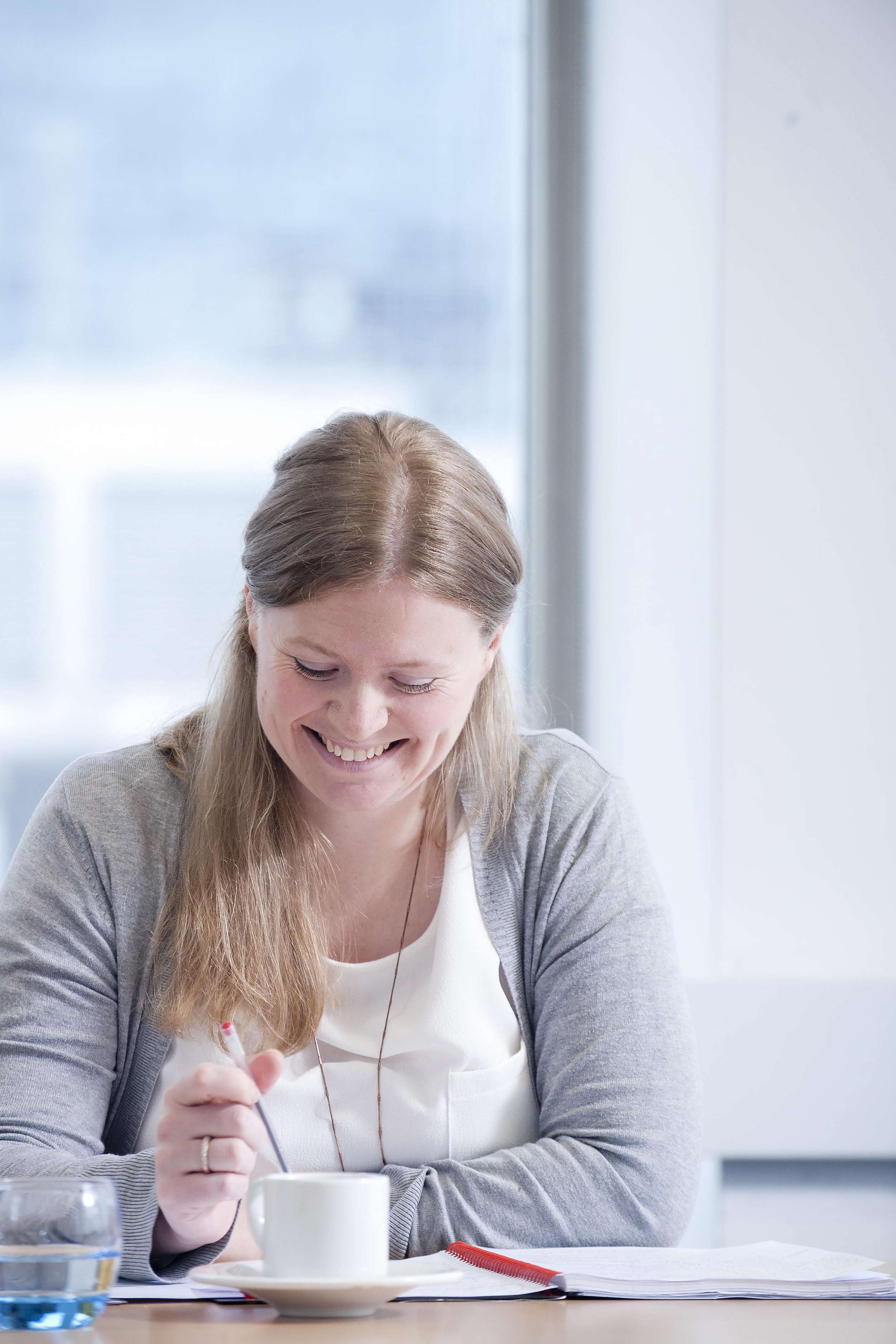Candid Portrait of a woman laughing at meeting in an office in London