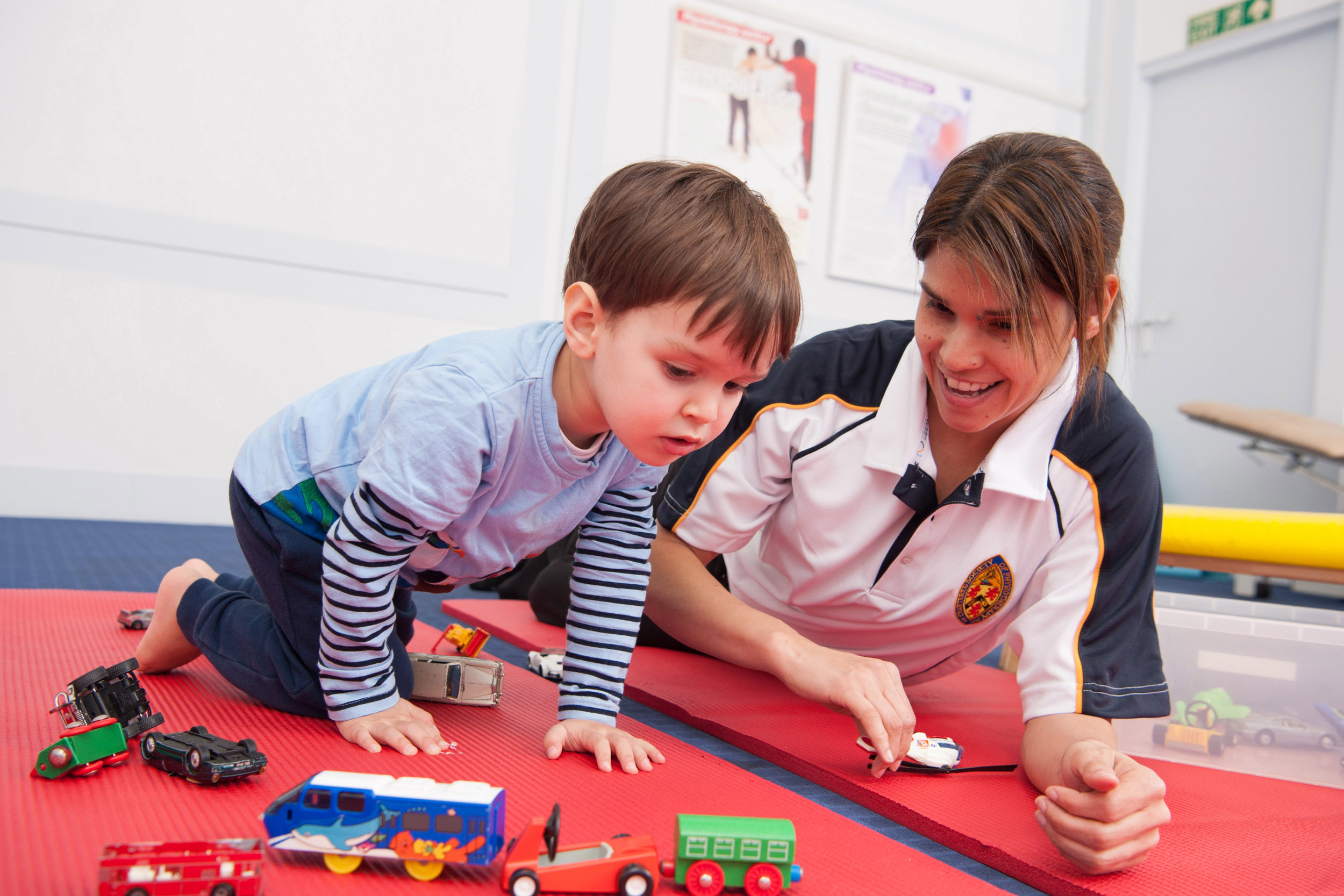 Physiotherapist playing with a child in play  environment