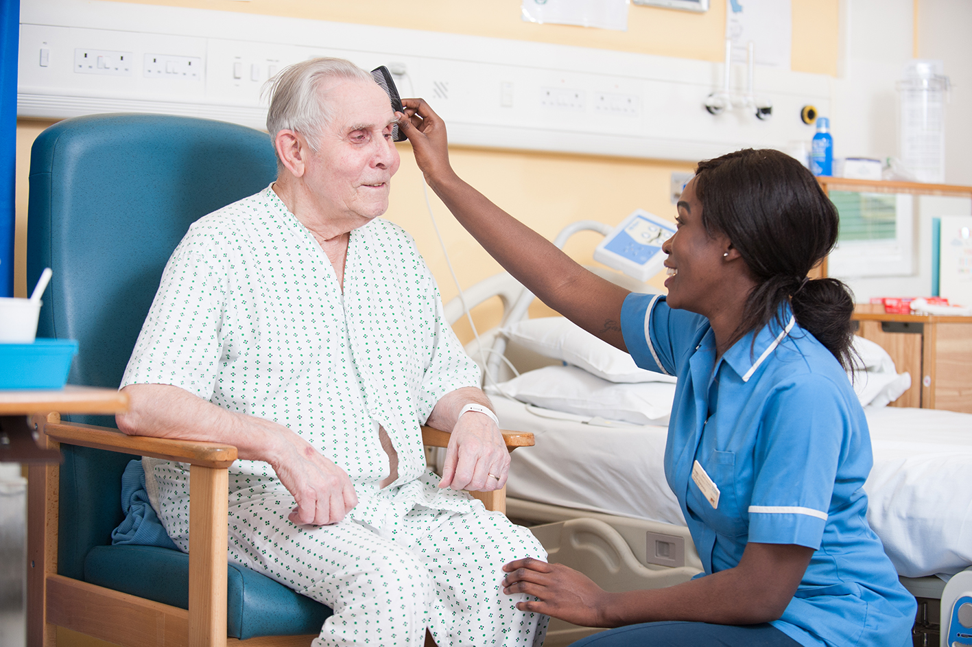 Portrait of Nurse caring for elderly patient smiling