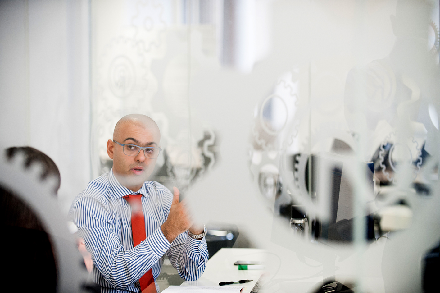 Candid reportage Image of a man in meeting in an office