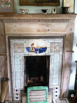 Fireplace in bedroom painted by Vanessa Bell