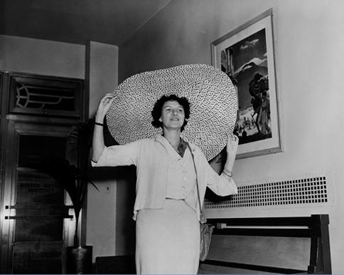 Famous art collector/socialite Peggy Guggenheim plays a fun role in the novel acquiring paintings from an artist Harold discovers.