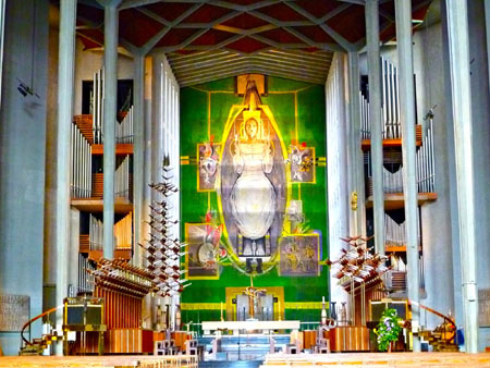 "Coventry Cathedral tapestry: ""His tapestry Christ in Glory, stood the full height of the building, its solid colours and softness a counterpoint to the brilliance of stained glass, gazing down the length of the nave at the ruins behind."""