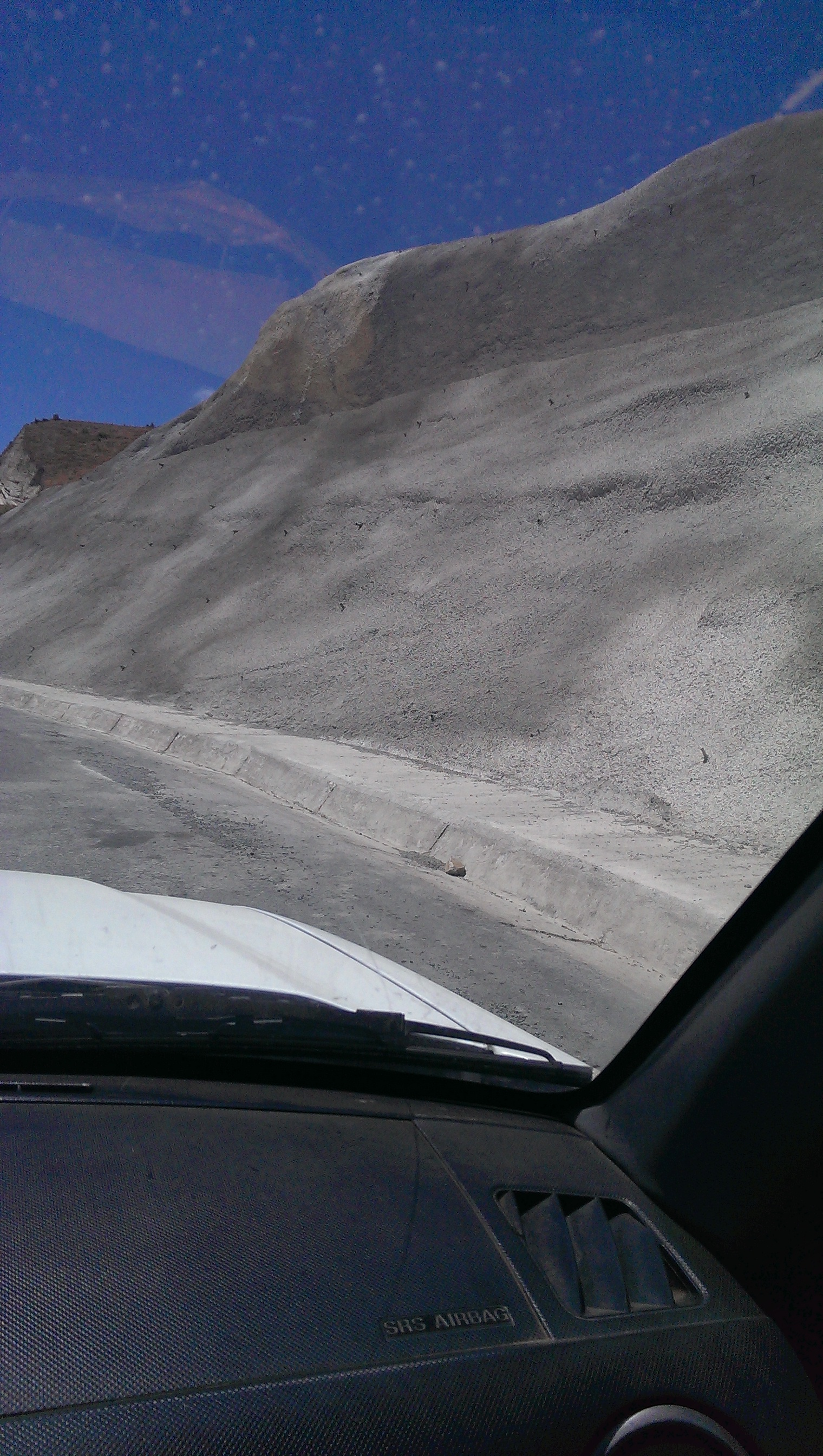On the drive to the crater - cliffs on either side of road were 'shotcreted' to help stabilize them