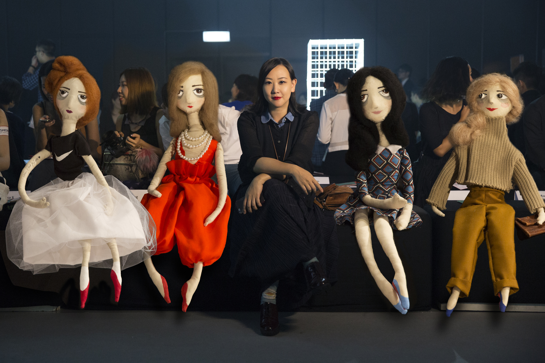 Ning Lau with some of her creations front row at a fashion show.