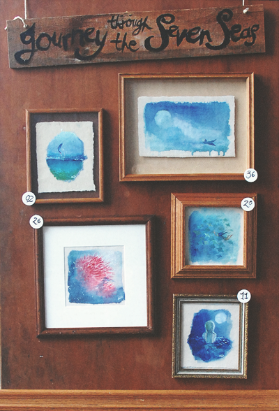(Display from 'Explorations Part 1: Journey Through the Seven Seas', Amy'straveling art show featuring paintings on handmade paper in vintage and found frames which will be at Artists & Fleas LA Feb 21st and 22nd. )