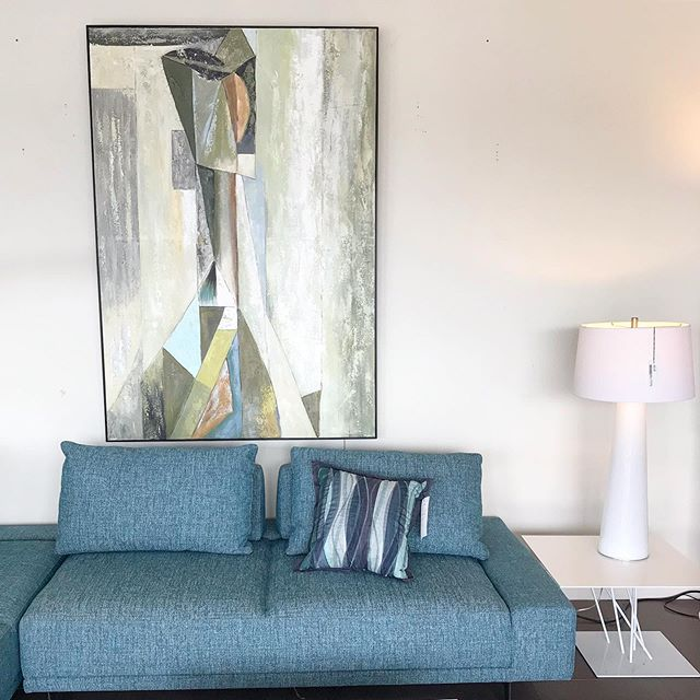 Loving the soft palette of this #contemporarypainting outfitted with a #modernsofa by @dellarobbiausa in #skyblue available now @gormansdesign