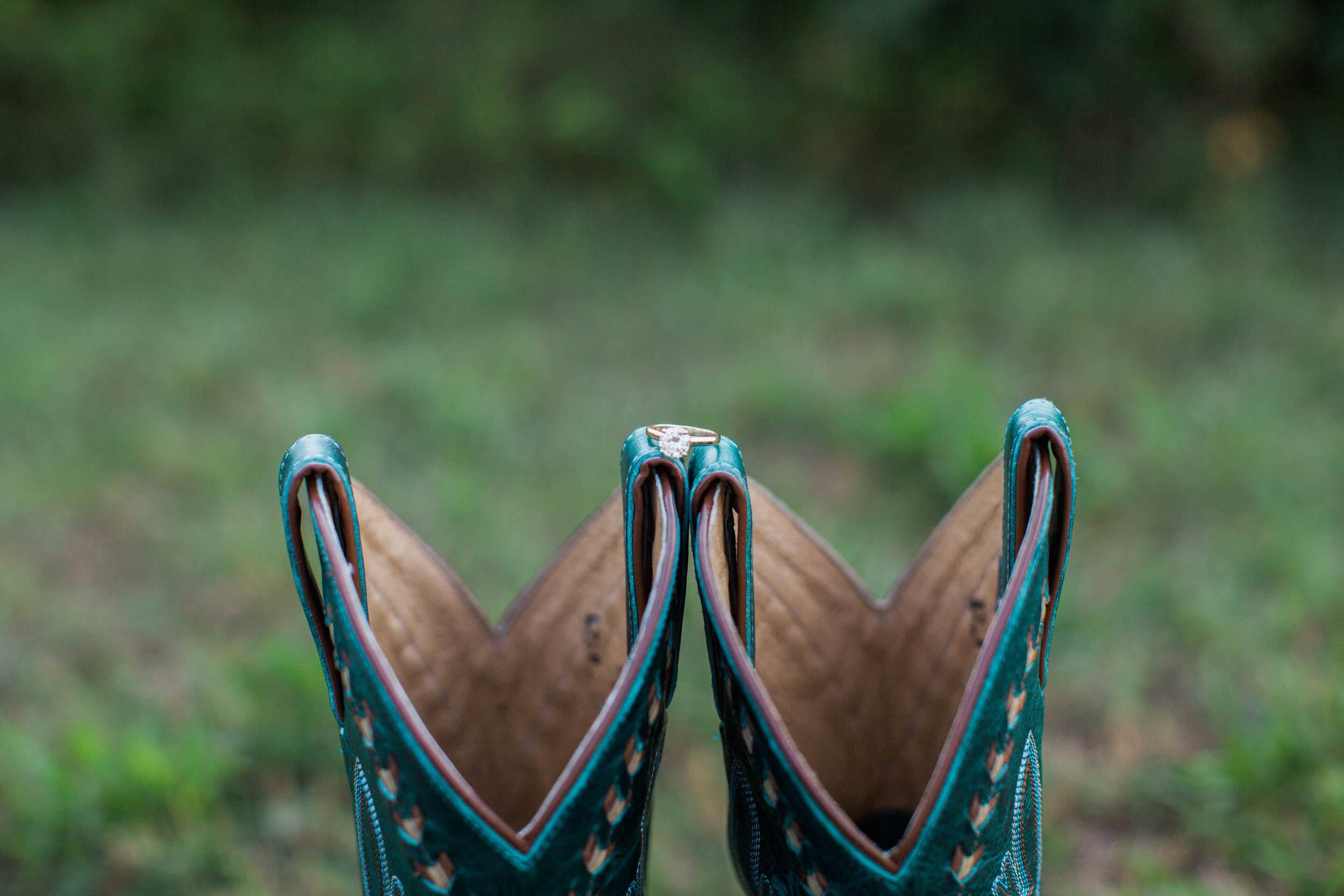 Engagement ring on cowboy boots at Ellery Farms