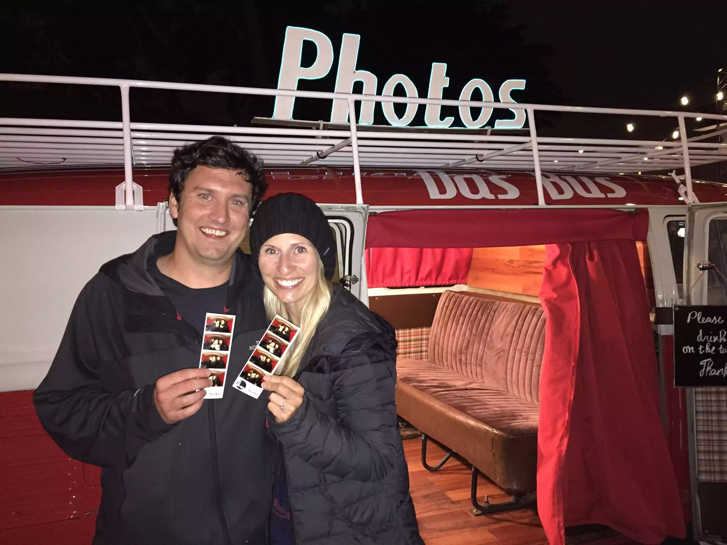 Shawn and Lacey with their engagement photos after Shawn popped the question in Das Bus!