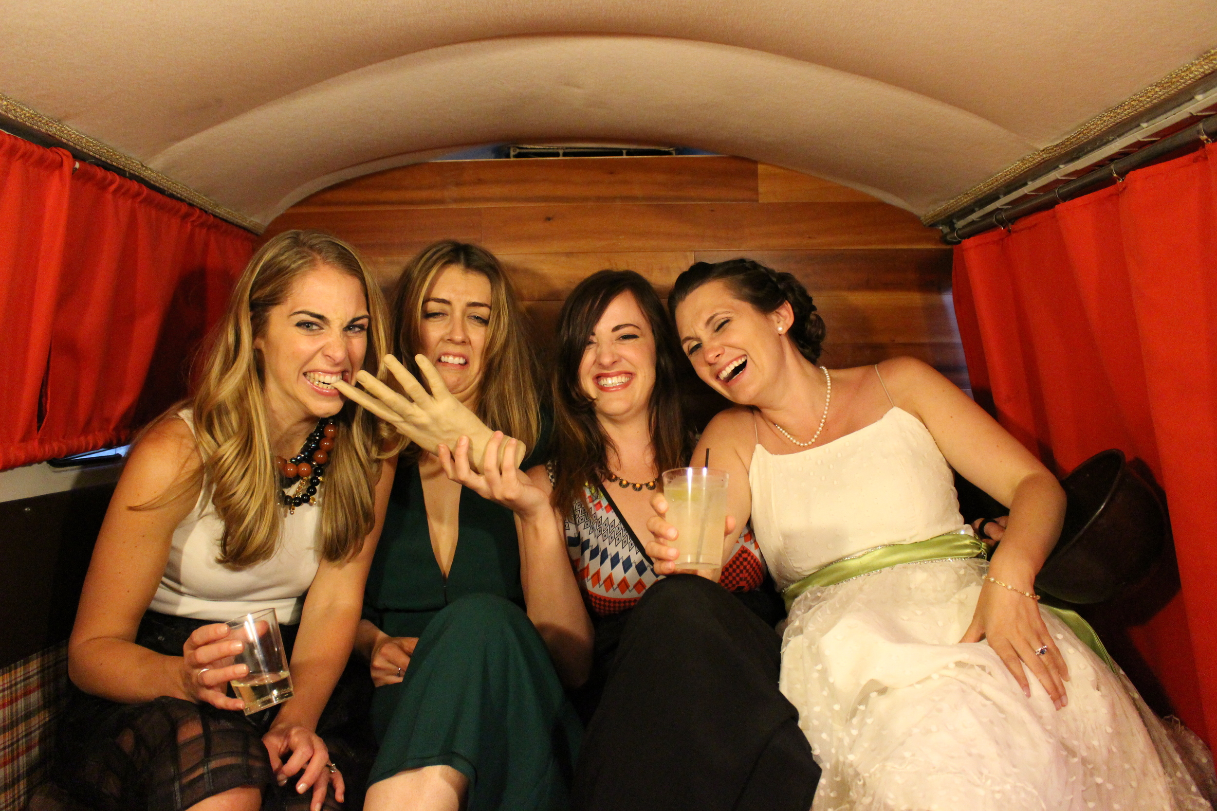The bride celebrating with friends in Das Bus!