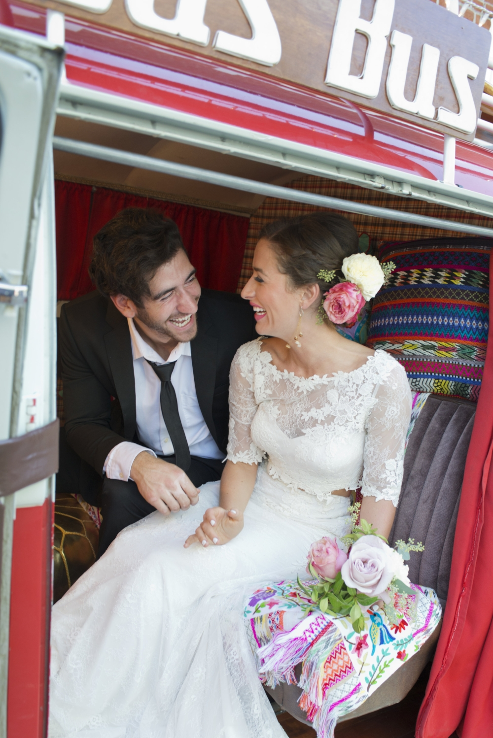 This couple was too much fun! Getting silly for their photo session in Das Bus. Photo by Christine Glebov.