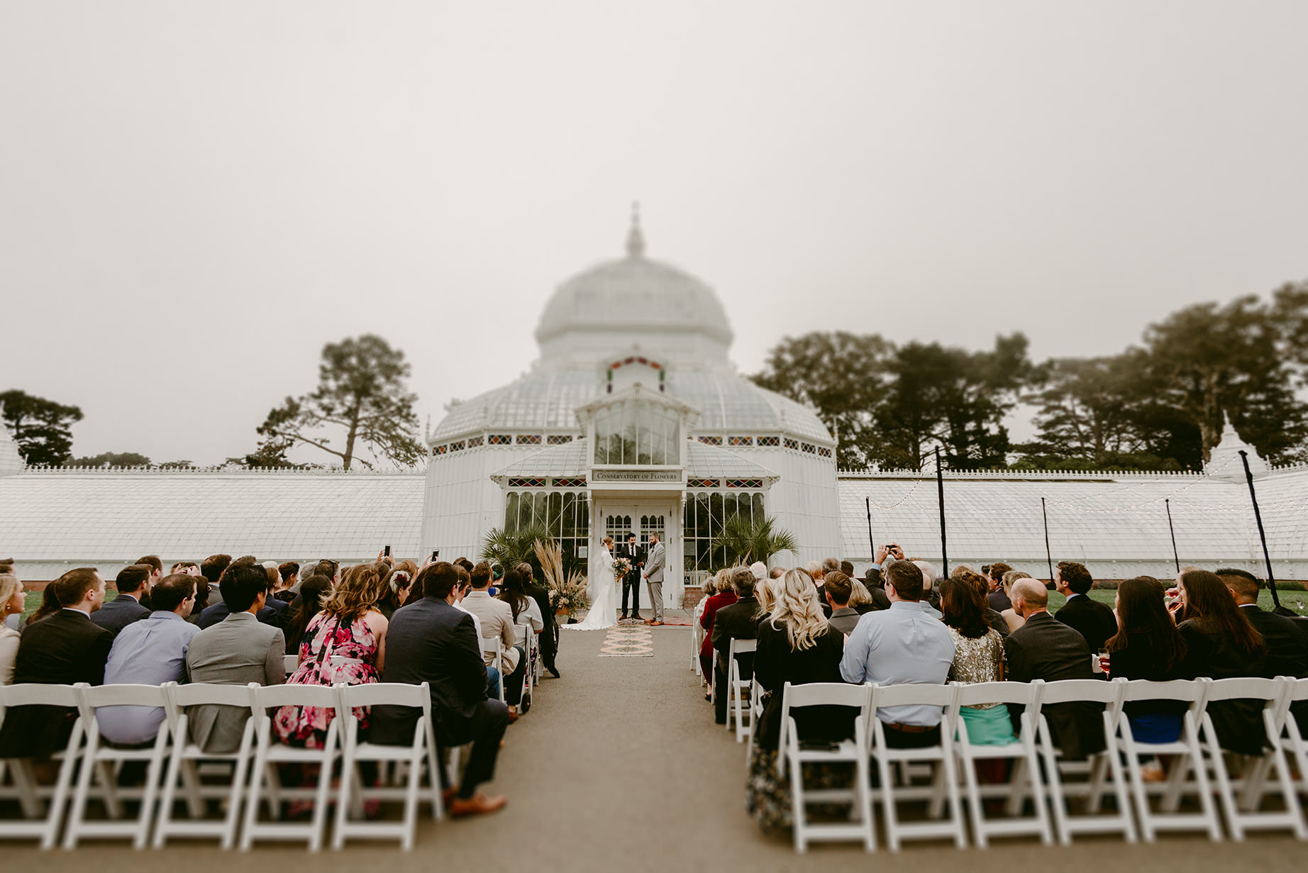 Ceremony at Conservatory of Flowers. Photo by Julie Pepin.