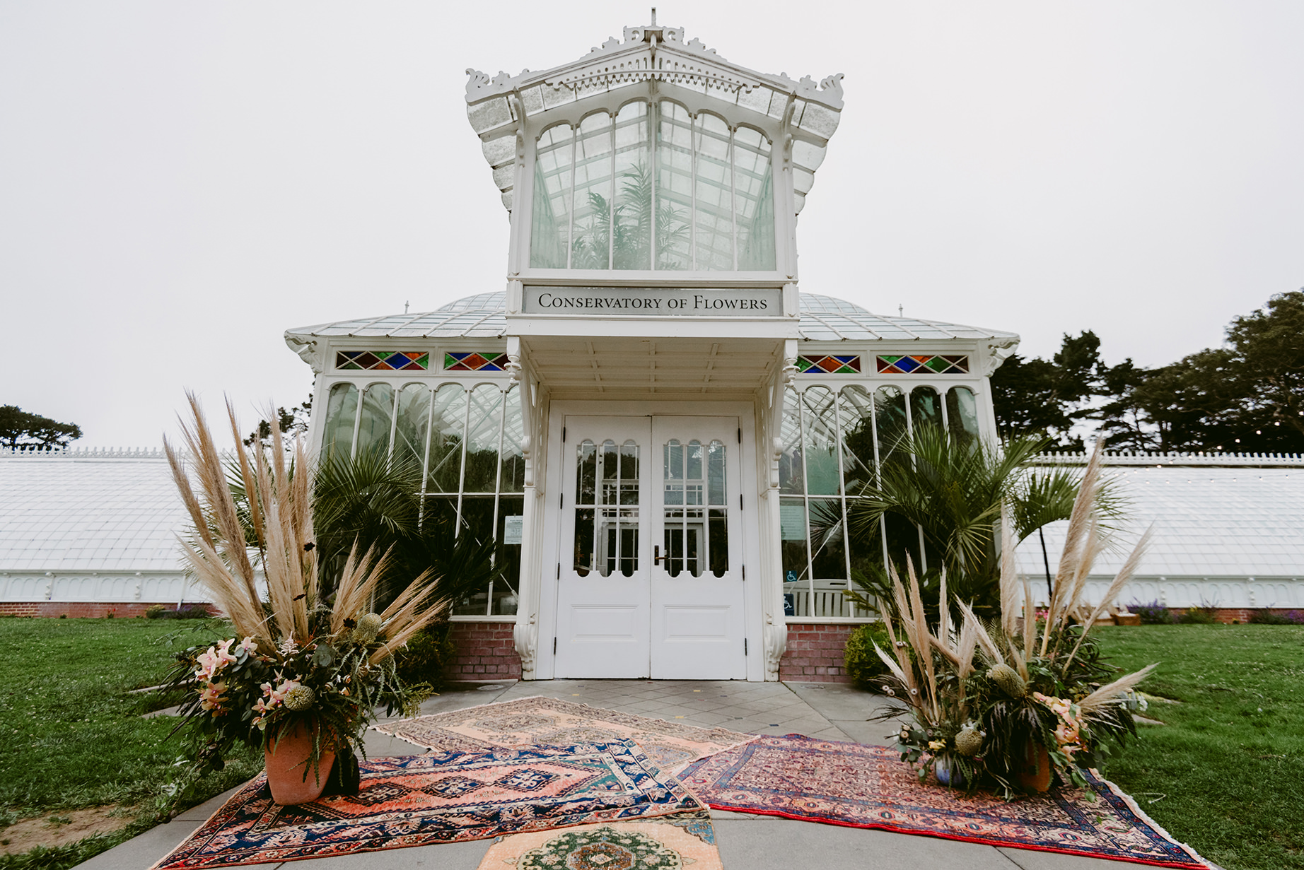 Conservatory of Flowers Wedding Ceremony Styling. Photo by Julie Pepin.
