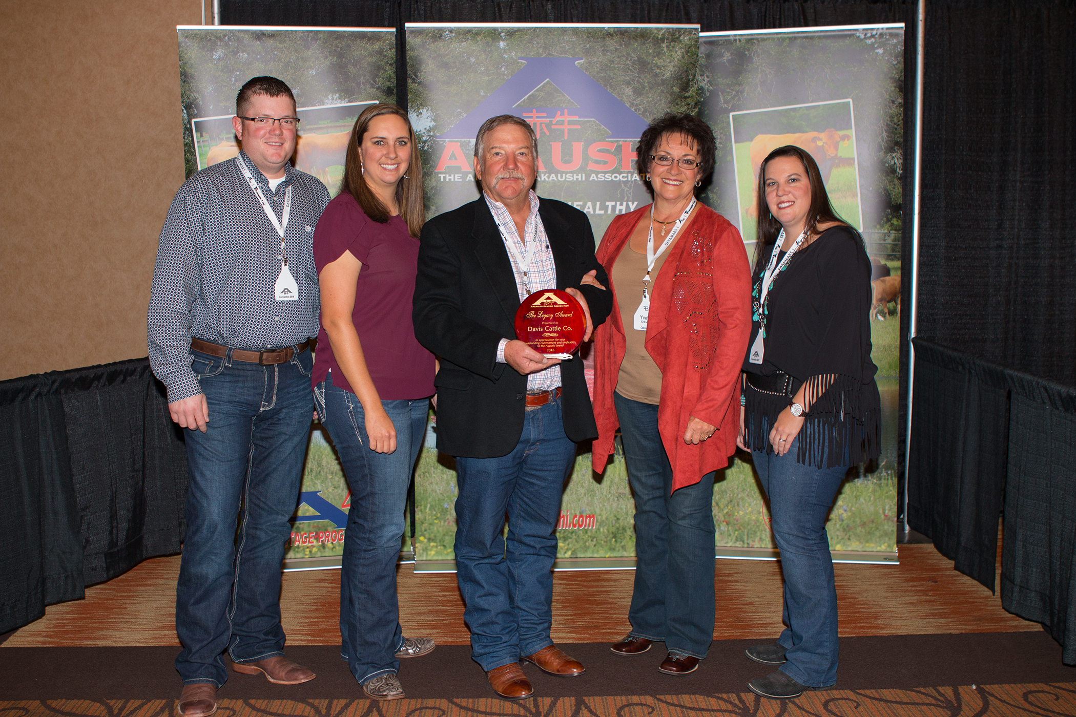 """Phil Davis and family of Davis Cattle Company - Bar O Ranch, Cascade, Idaho were presented The American Akaushi Association """"Securing The Legacy Award"""" at their recent convention in Lubbock, Texas. This award is presented annually to the individual, family or ranch, that has provided key leadership and marketing efforts for the American Akaushi.    L to R: Will Caldwell, Katlin Davis, Phil And Yvette Davis, Sarah Davis Swain"""