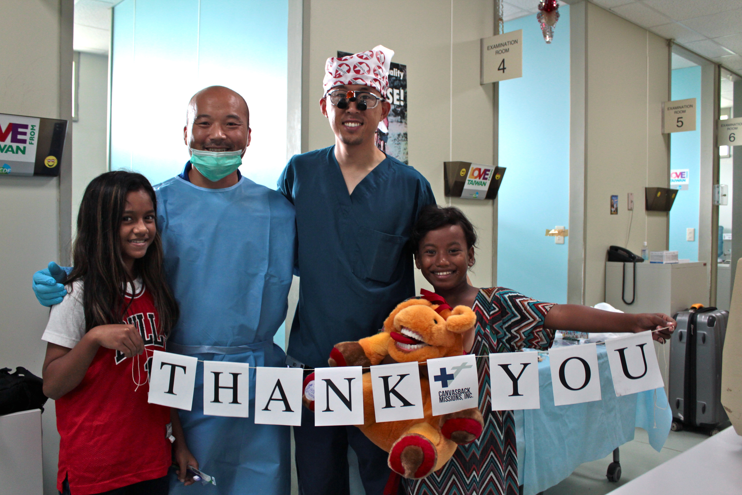 Two Canvasback dentists with two of their patients—all four of them thank Septodont for their generous donations.