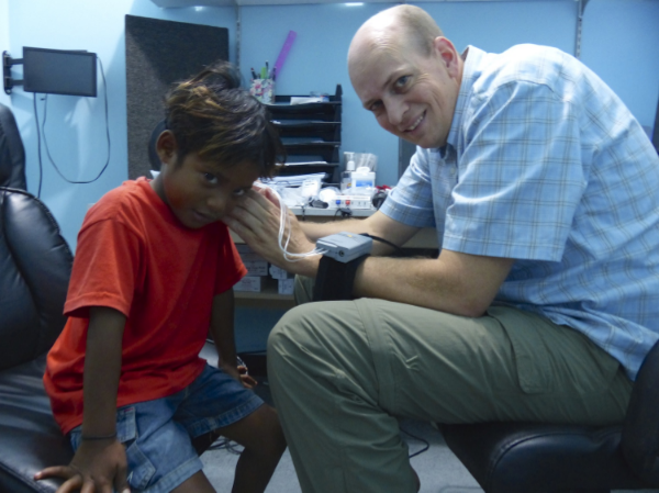 Dr. Thompson tests a boy's hearing at Majuro Hospital.