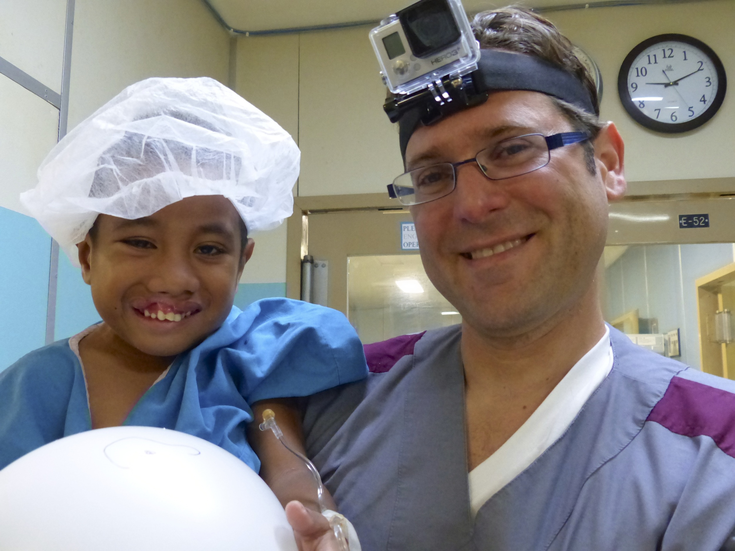 Dr. Dagan with a cleft lip patient.