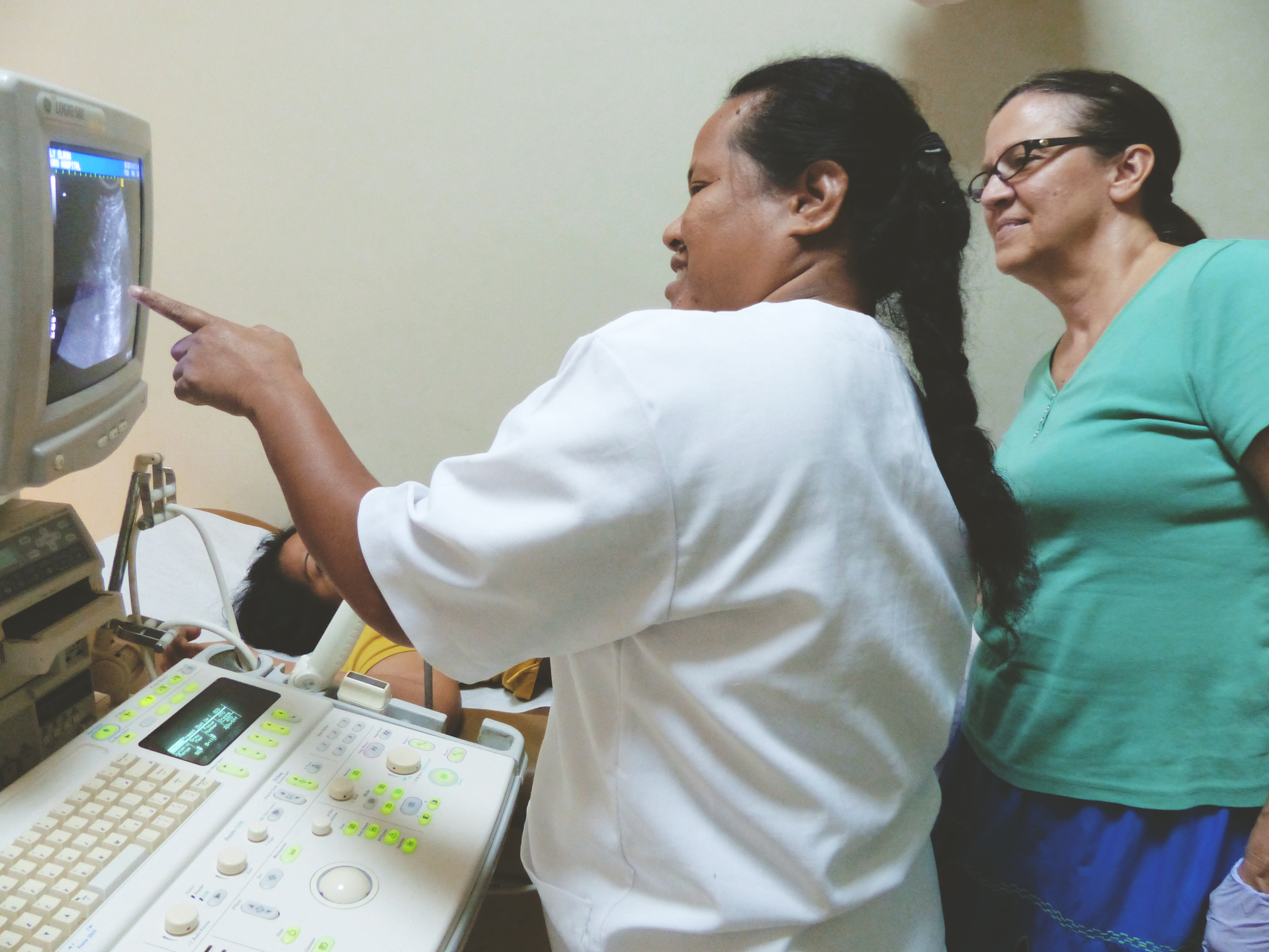 Susan Price, right, trains hospital staff in the latest ultrasound studies in 2014.
