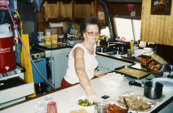 Onboard the  Canvasback , our faithful vessel, a volunteer cooks a healthy meal for the rest of the crew.