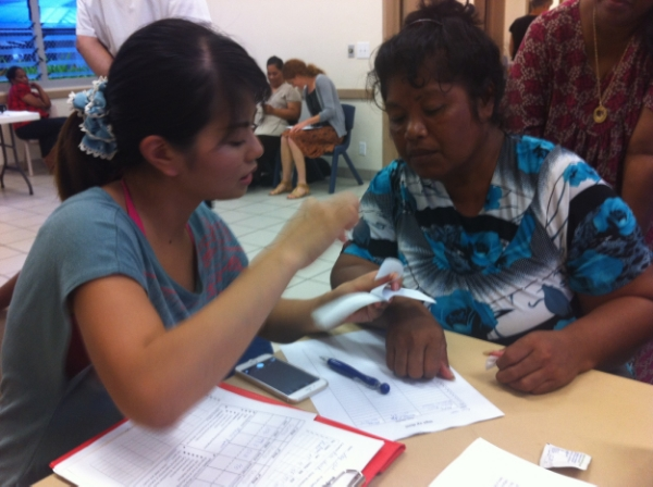 Nicki Hsu, from Taiwan Health, helps screen for diabetic patients on Majuro.