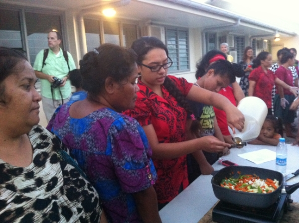 A Wellness Center volunteer teaches healthy cooking at a healthy cooking demonstration on Majuro.