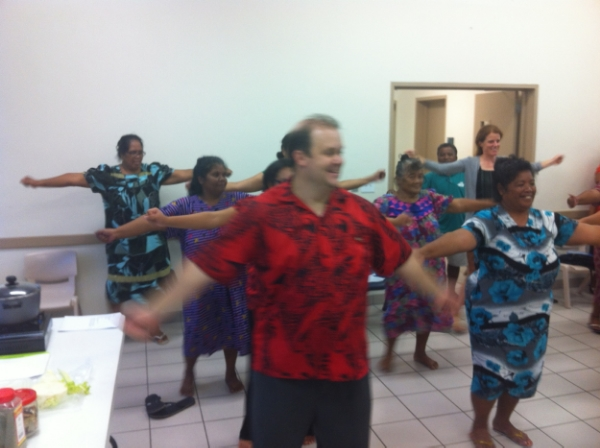 A healthy lifestyle can be fun and culturally integrated. Here, Wellness Center Director Tanner Smith dances with a class of ladies from Majuro.