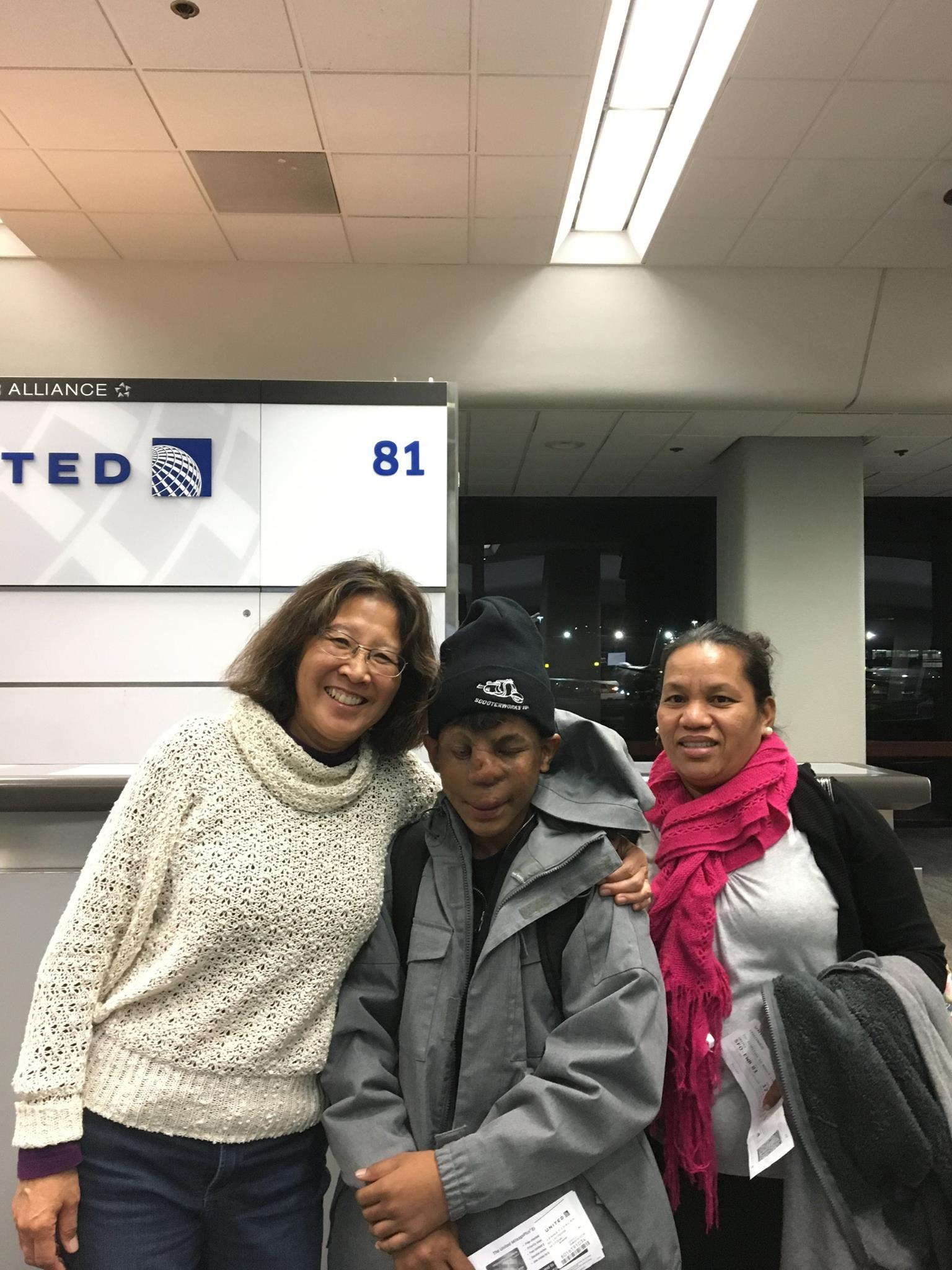 Executive Vice President Jacque Spence with Dallen and his mom Ingrid in San Francisco, as they head to their second trip to New York.