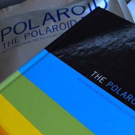 The Polaroid Book , and a copy with its original wrapper.