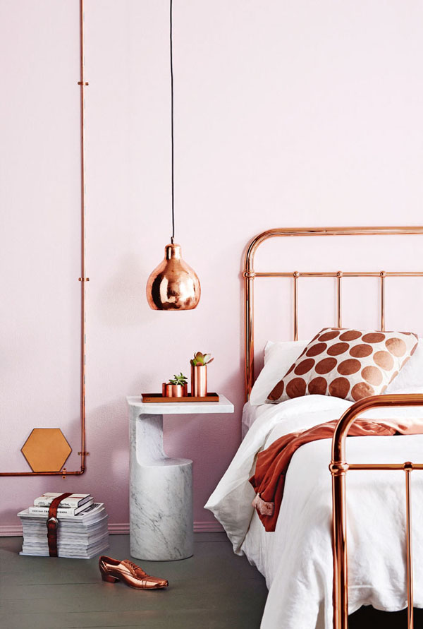 Copper   galore! From the bed frame to the accents, the warm tone is beautiful in a soft pink bedroom -  Image via April and May
