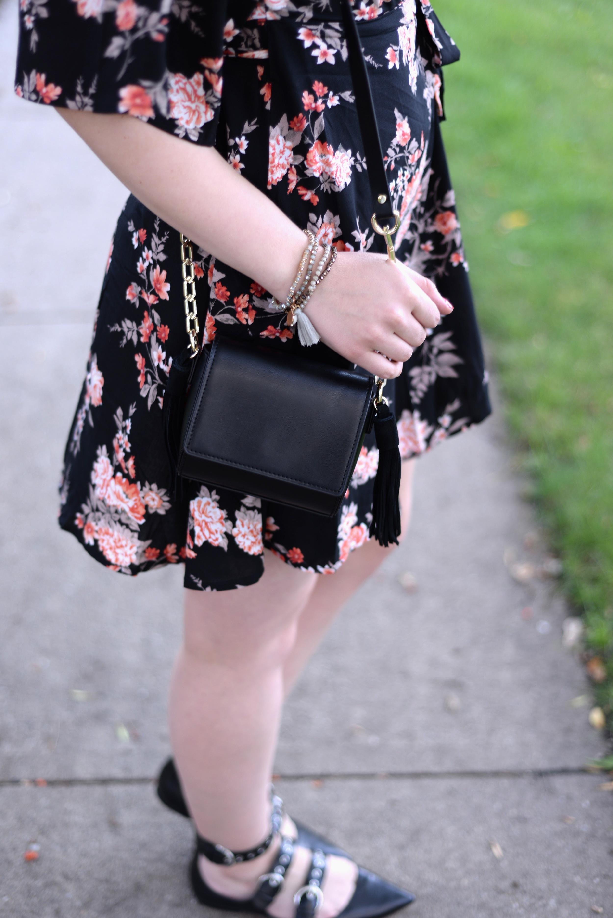 black purse with tassels