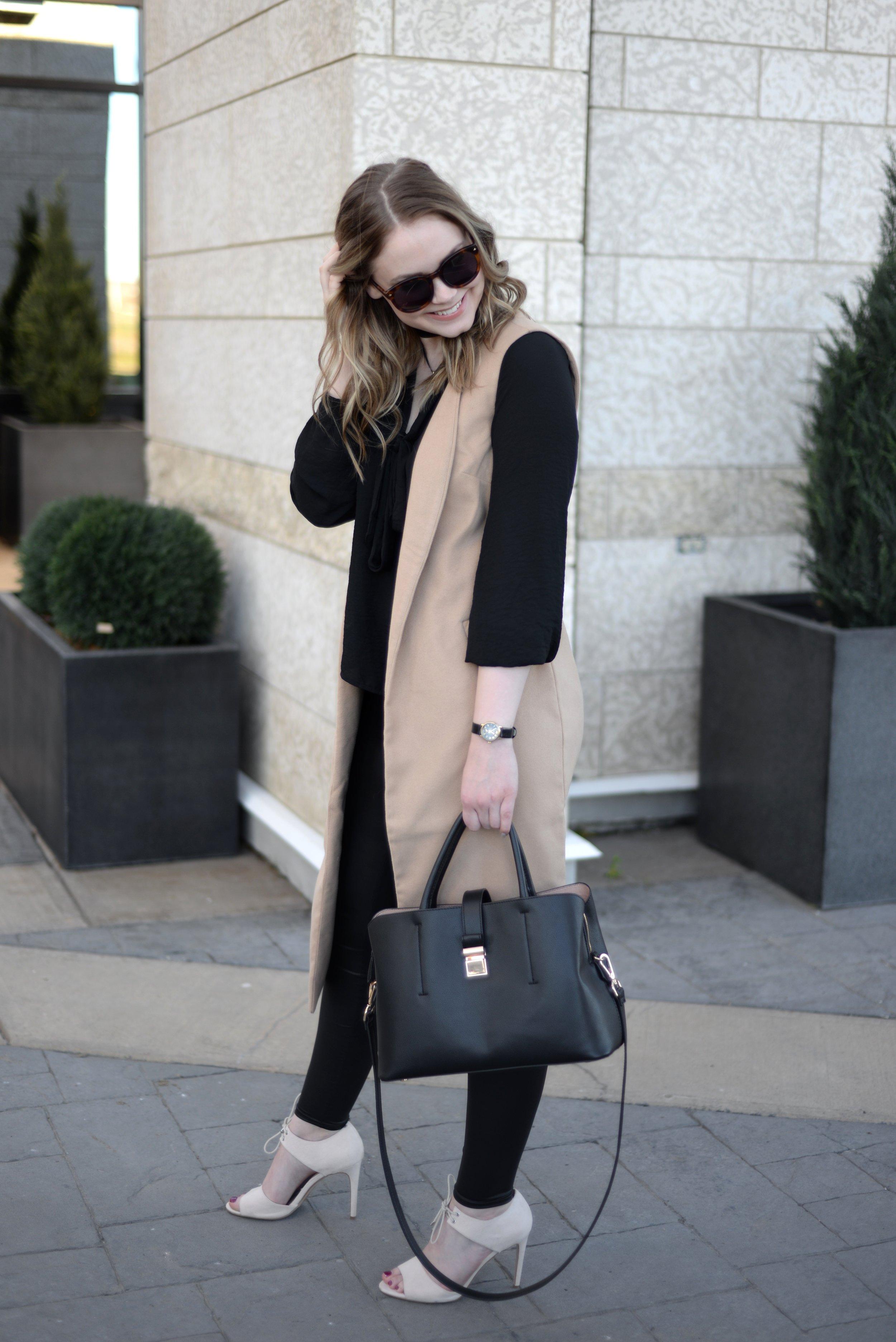 sleeveless vest and leather leggings