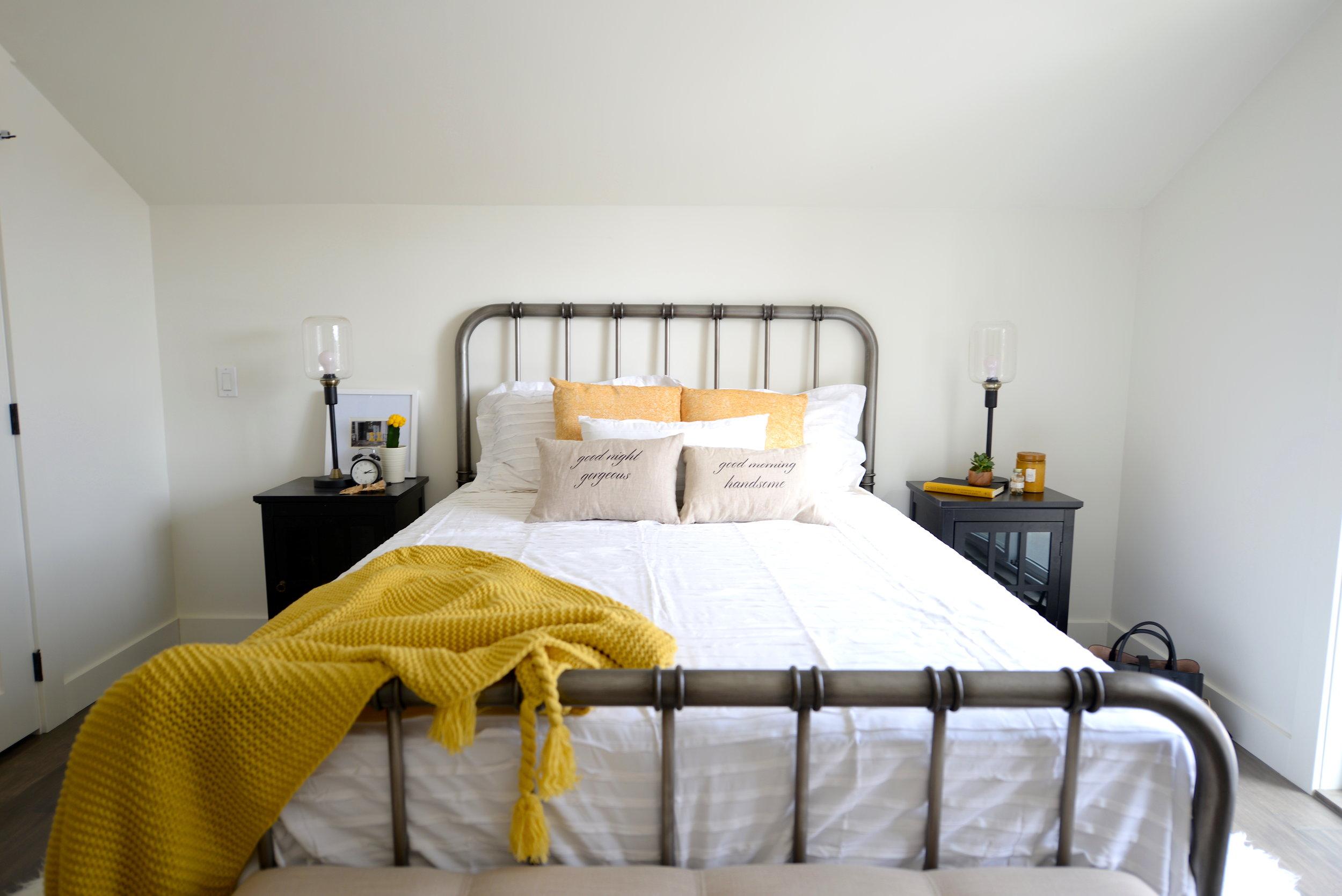 bedroom with pop of yellow