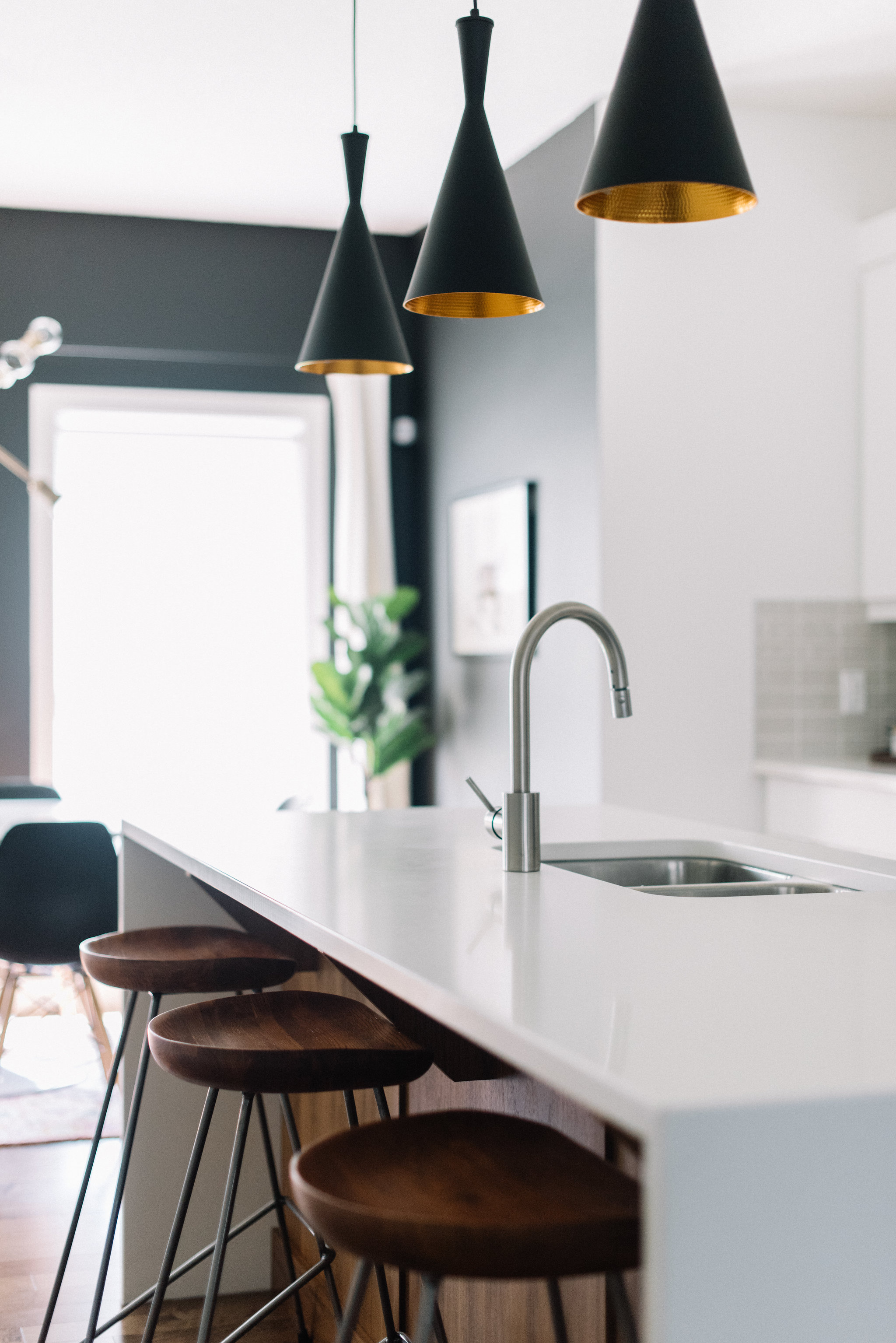 white modern kitchen, wooden barstools
