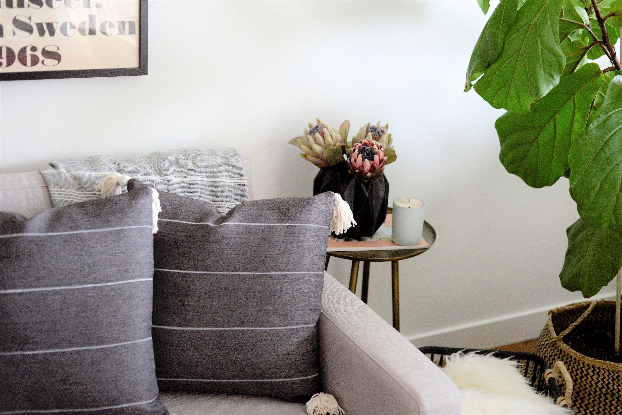 grey striped cushion with tassels - DIY