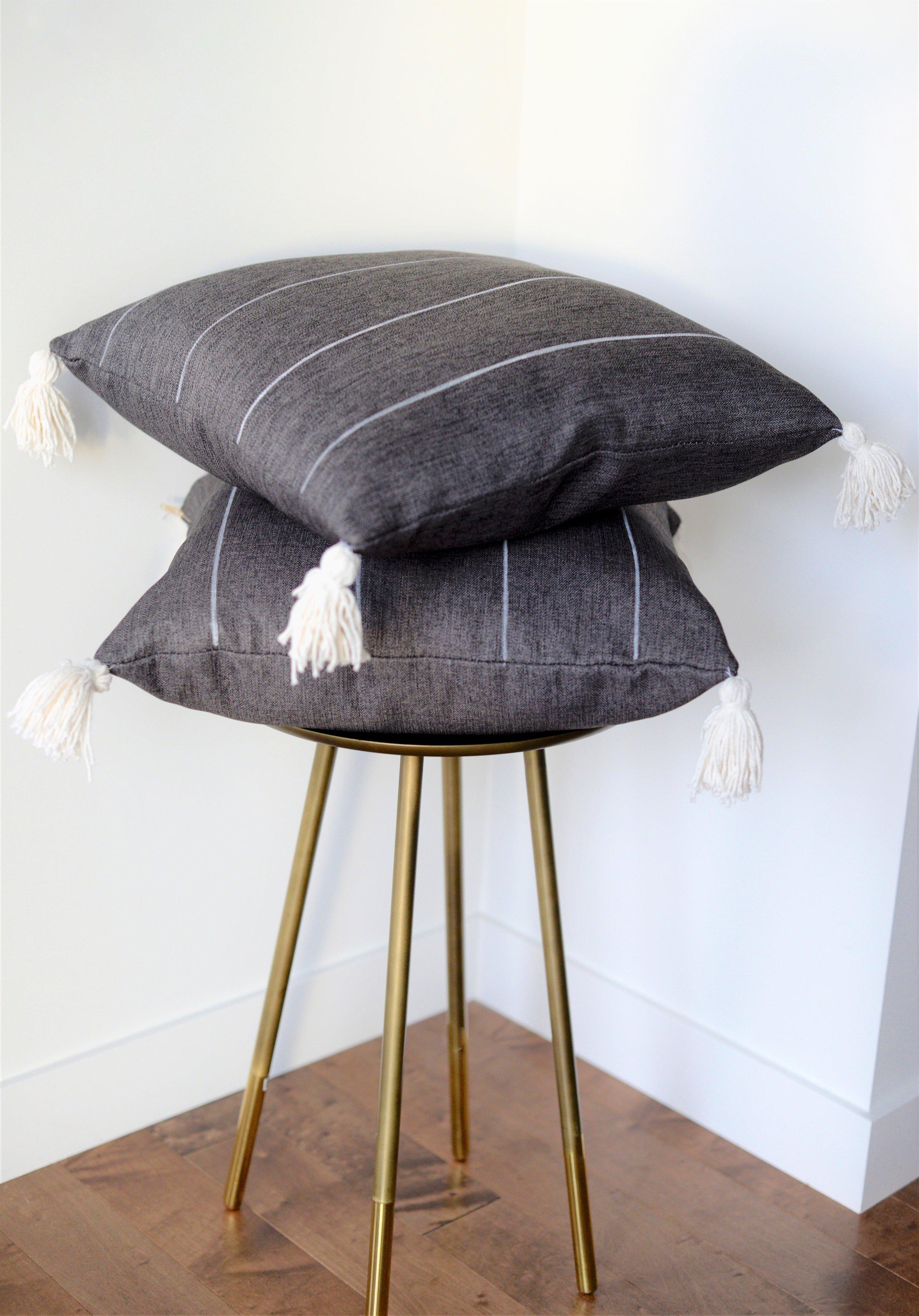 grey striped cushion with tassels DIY