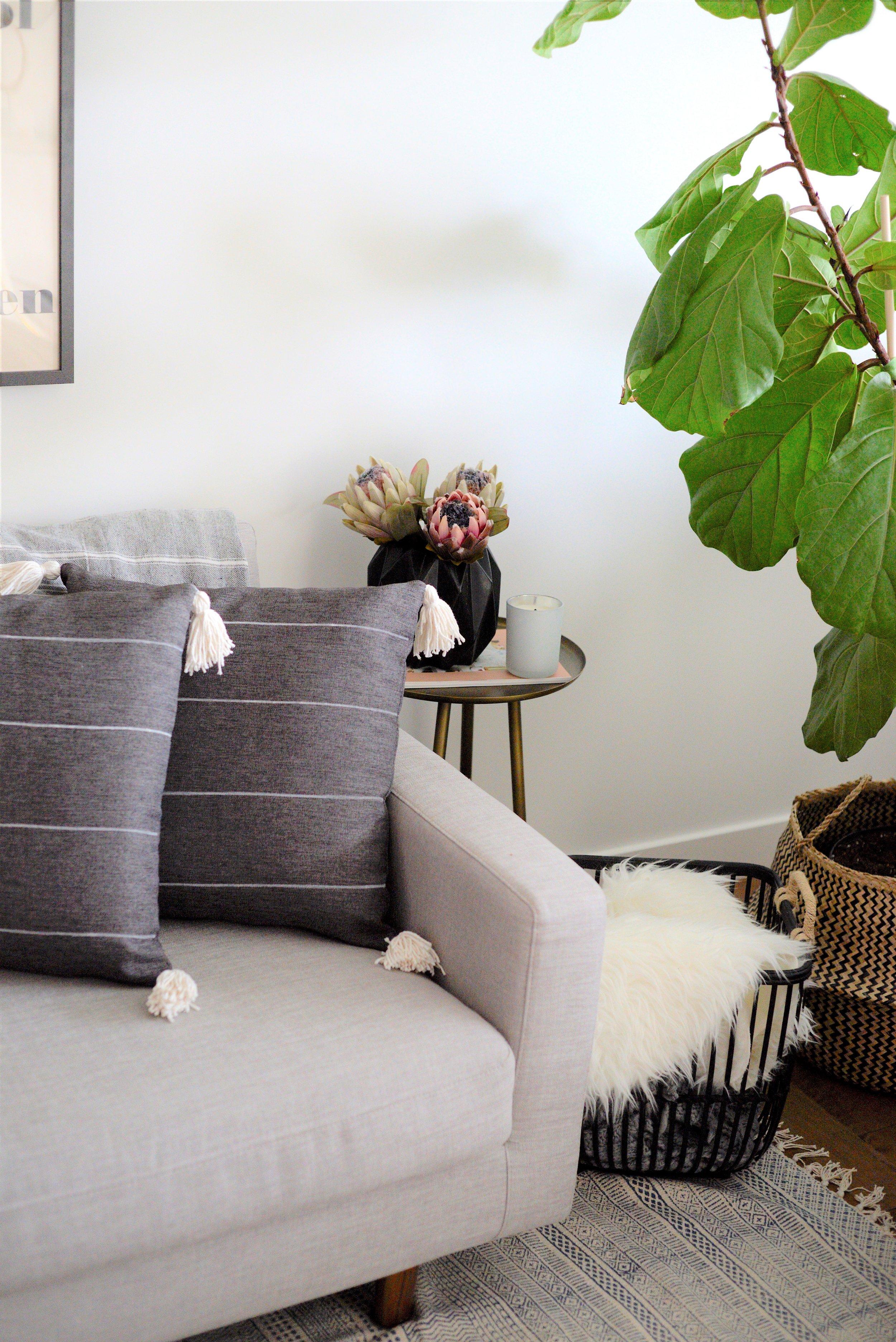 grey striped cushion with tassels
