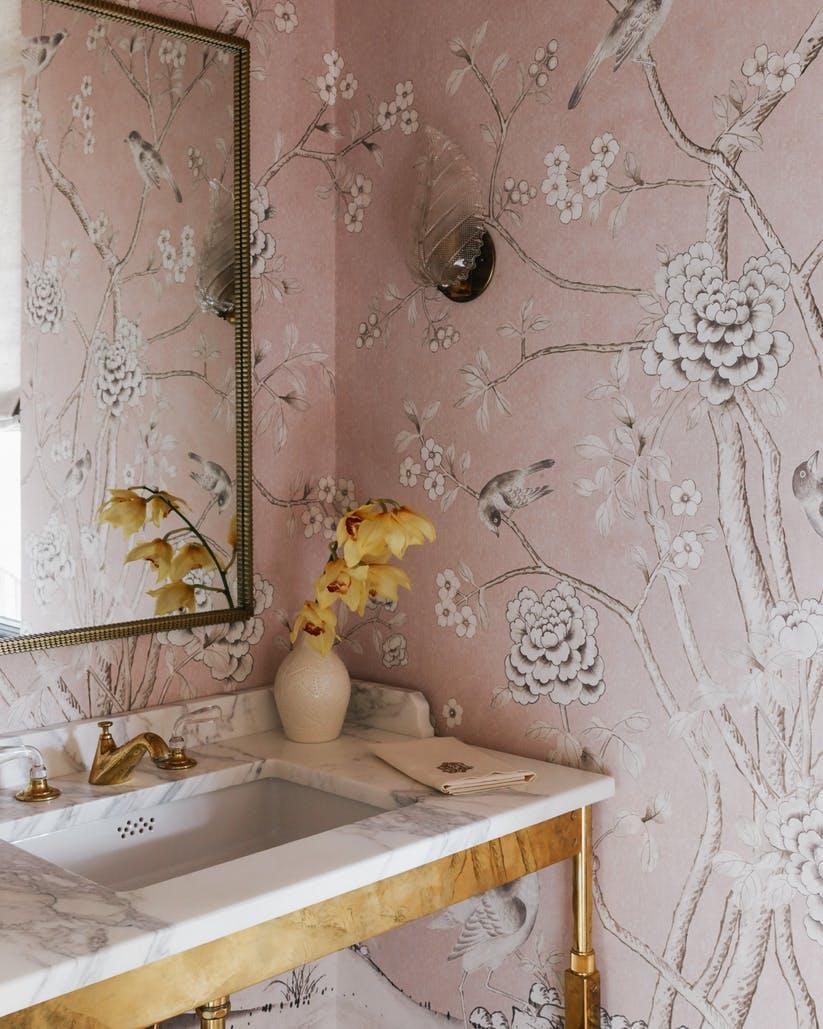 powder room with blush pink wallpaper