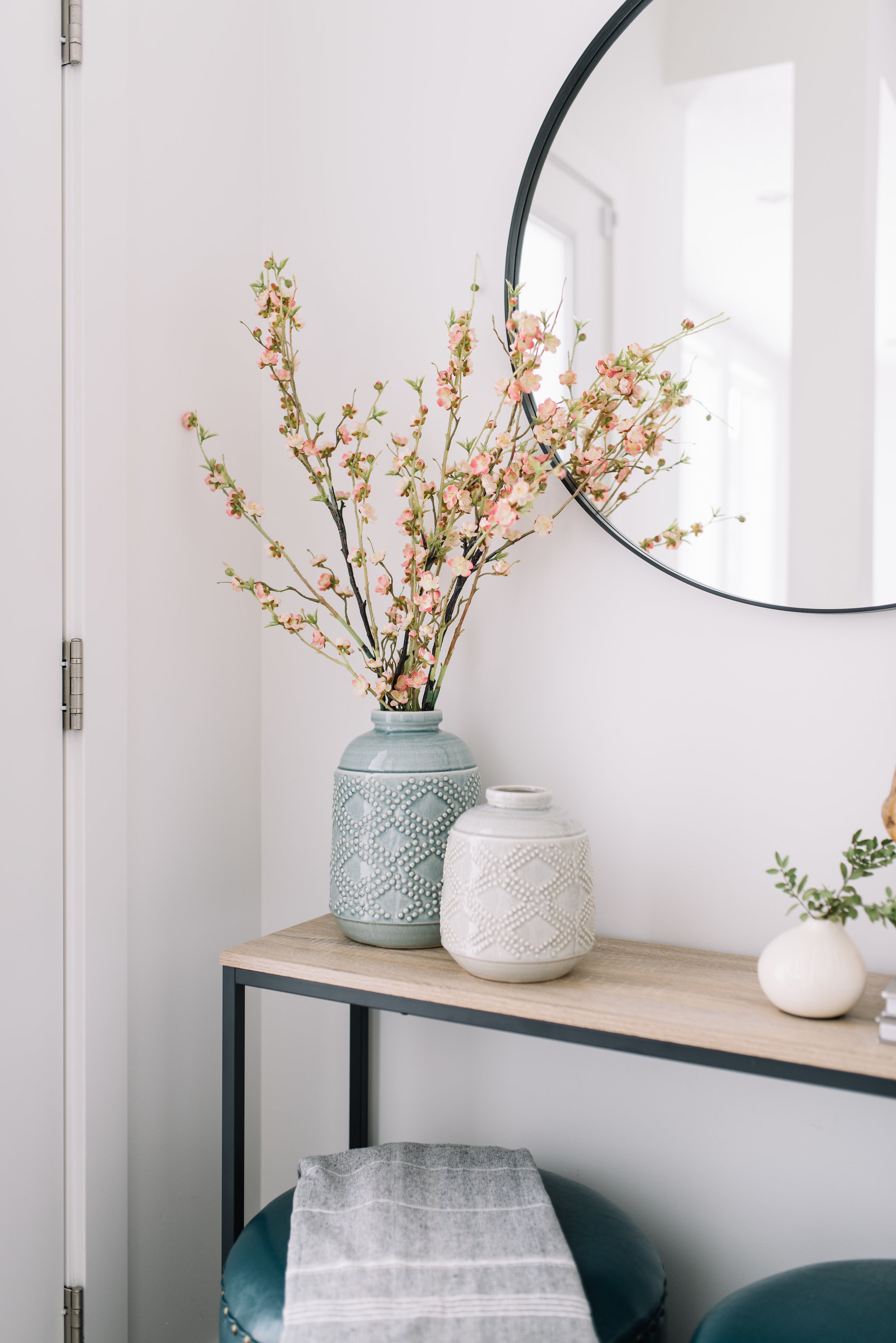 front entry round mirror, blossoms