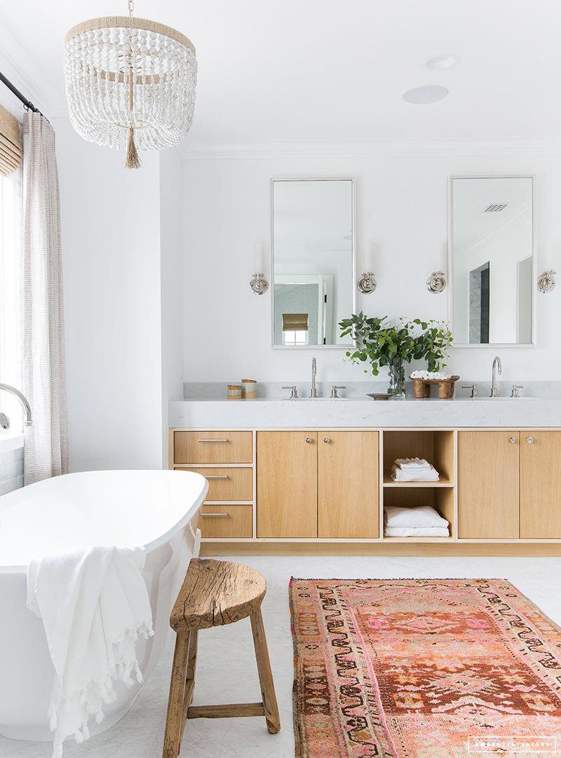 white bathroom with light wood vanity