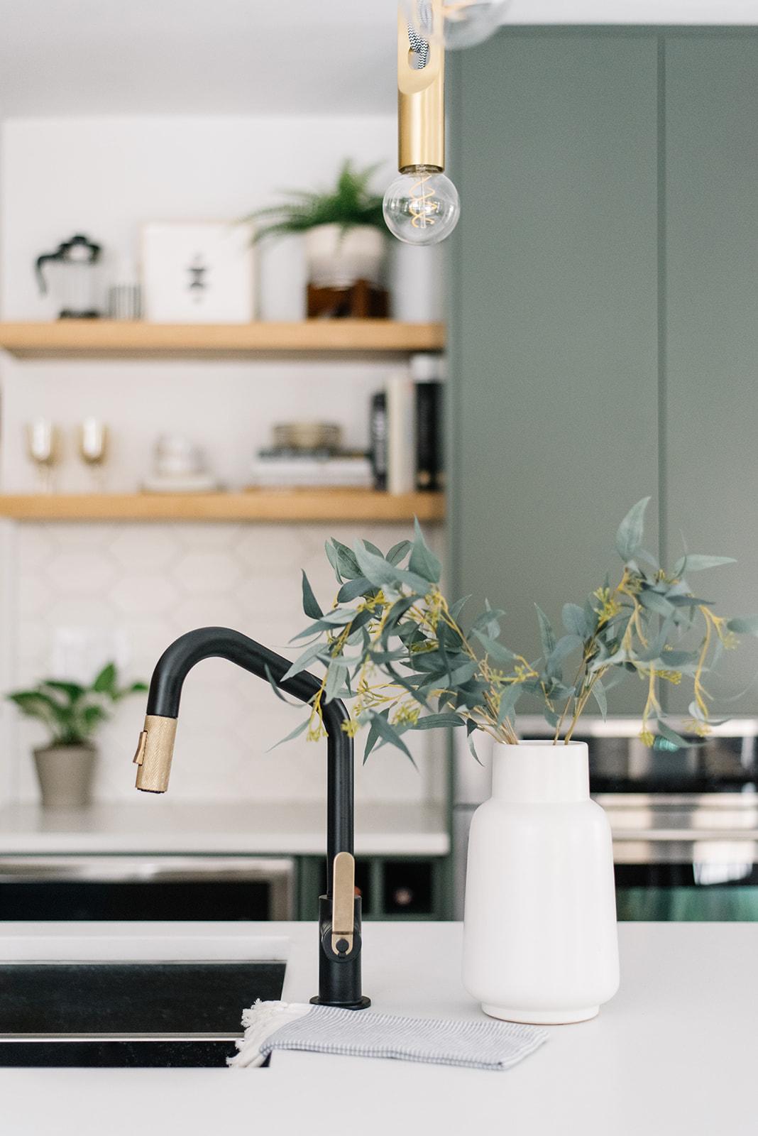 brizo litze black and brass kitchen faucet