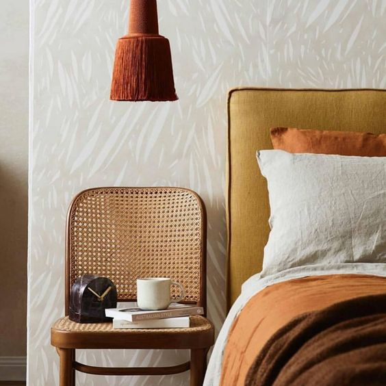 bedroom with rust and mustard colors
