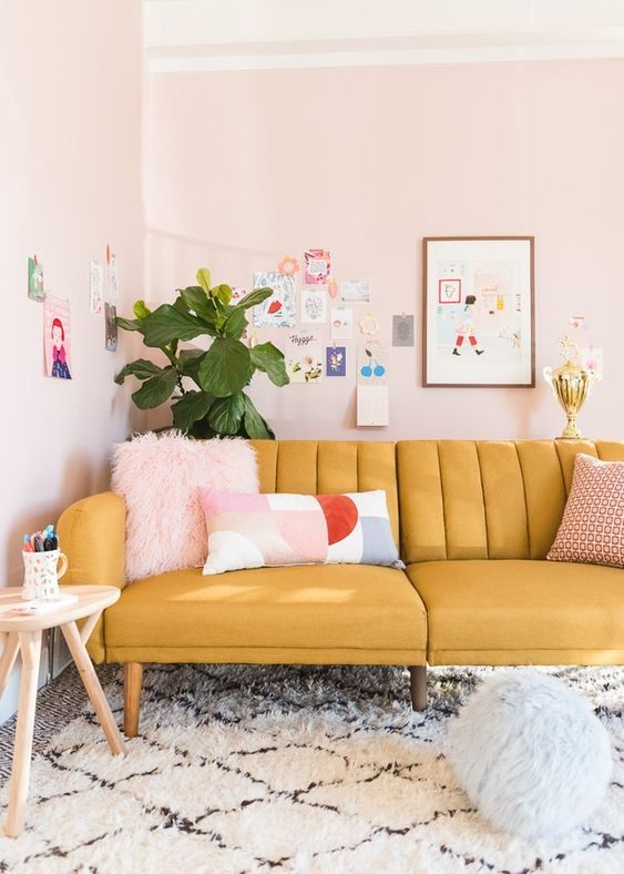 channel tufted mustard sofa in blush room