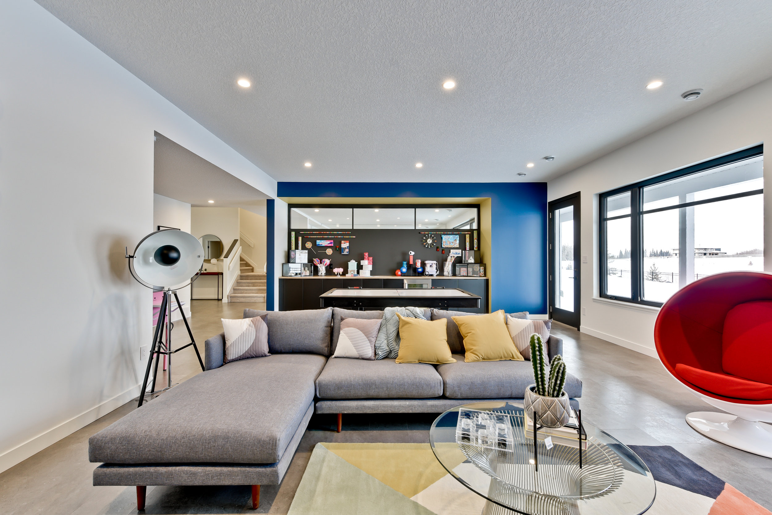 mid century modern basement with candy bar