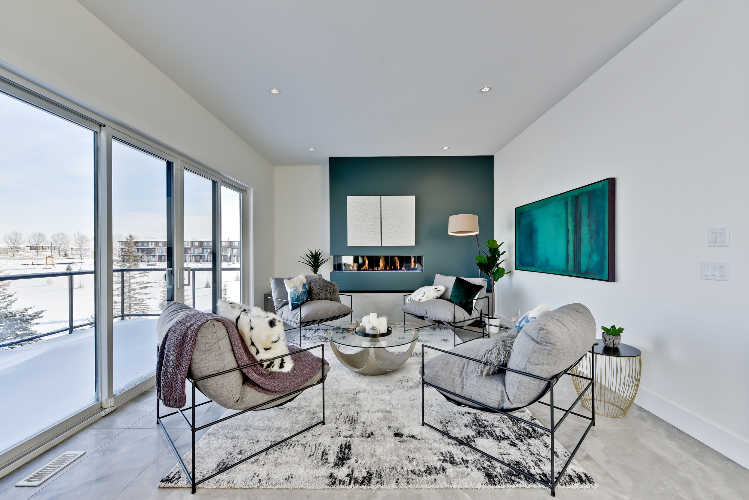 modern sitting room with teal accent