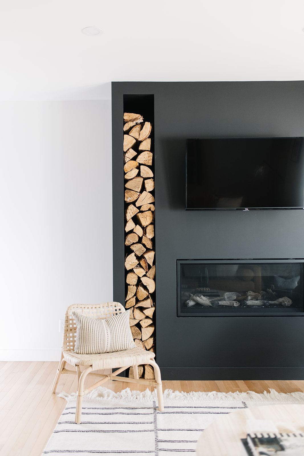modern fireplace with vertical wood storage
