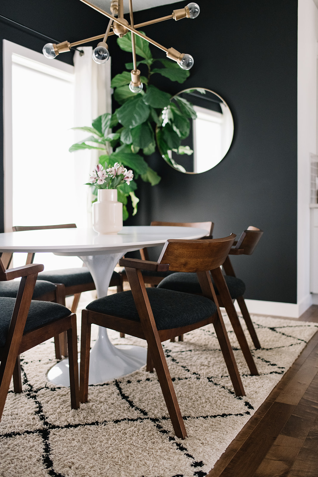 white dining table with walnut dining chairs