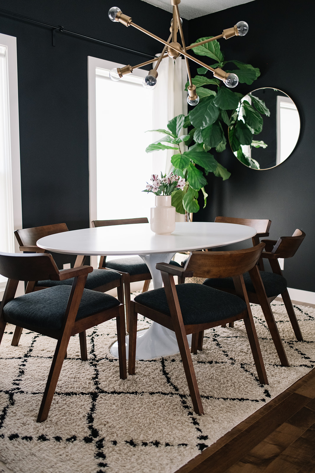 white dining table with walnut chairs
