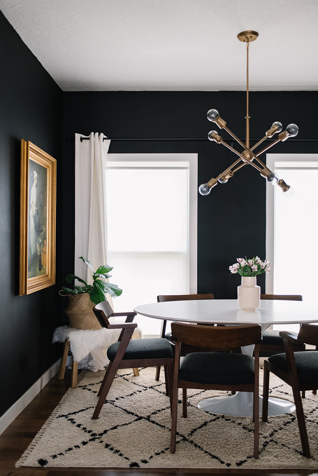 modern black dining room with walnut chairs